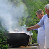 Ipswich: Andy Kaszuba, right, and Mark Perrone take care of the grill during the Greek Festival.  Photo by Mark Teiwes / Salem News