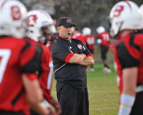 Salem: Salem High School varsity football head coach Scott Connolly runs warm-up drills before a game .   photo by Mark Teiwes / Salem News