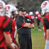 Salem: Salem High School varsity football head coach Scott Connolly runs warm-up drills before a game .   photo by Mark Teiwes / Salem News