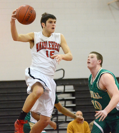 Marblehead: Marblehead's Tommy Stockwell looks for a pass defended by Lynn Classical's Josh Cheever.  photo by Mark Teiwes / Salem News
