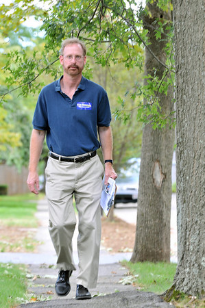 Beverly: State Representative candidate Scott Houseman campaigns door to door along Bass River Road in Beverly.  photo by Mark Teiwes / Salem News