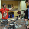 "Hamilton: Connor Suarez of Salem, left, celebrates a kill point after he ran some of Trevor Attridge's pieces off the board.  Trevor, 18, of Essex, later won the match by countering with a ""hail of psi cannons"".  The Battle-Gaming of Massachusetts club for teens meets on Saturdays at the Hamilton-Wenham Public Library.    photo by Mark Teiwes / Salem News"
