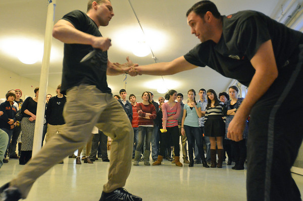 Swampscott: Greg Zanni, left, and Ryan Reilly demonstrate Krav Maga, Israeli martial arts), during the community event. photo by Mark Teiwes / Salem News