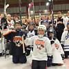 Gloucester: Youth hockey players from the Danvers and Beverly leagues skate with the Danvers and Beverly varsity girls and boys hockey teams.  photo by Mark Teiwes  / Salem News