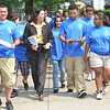 Salem: Adrison Perez-Brea, left, Esquerlina Nina, Mayor Kim Driscoll,  Jenifer Morales, Isaac Morales, Yaritza Delgado, Barbara Rivera walk along Lafayette Street.    City officials tours problem properties in the point led by a group from the STAND program (Summer Teen Action for Neighborhood Development) through the North Shore CDC.  photo by Mark Teiwes / Salem News