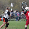 Ipswich: Ipswich's Mikhala Reedy, left, breaks into the zone to score on  Masco goalie Reb Horgan. Mark Teiwes / Salem News