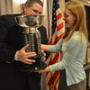 Danvers: Salem News sports editor Phil Stacey presents a trophy to  Olivia Raisner of Marblehead High School, the 2011 Student-Athlete Award winner.  photo by Mark Teiwes / Salem News