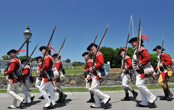 Marblehead: The King's Own 4th Regiment of Foot, a British re-enacting group, march off to battle. photo by Mark Teiwes / Salem News