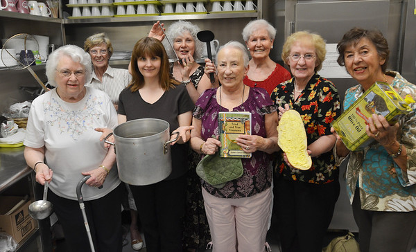 "Danvers:  The seniors at the Danvers Senior Center have whipped up a cookbook of 220 recipes called ""Tried and True Treasures"" and they are going to have a tasting on Thursday, June 16th from 5 to 7 p.m. at the Senior Cener.  Admission is $10, which includes the tasting and a cookbook.  Proceeds will be donated to help purchase kitchen equipment. Those posing with the cookbook are Barbara Chambers, left, Claire O'Brien, Lorene Machado, Donna Eovacious, Marion Kelley, Millie Hoppich, Kathy Sheridan, and Sophie Webber.  photo by Mark Teiwes / Salem News"