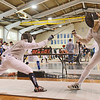 Danvers: St. John's Prep won the state fencing tournament on Saturday.  St. John's Prep fencer Dan Burke scores a point on his way to win a bout with Ethan Edwards from the Commonwealth School. photo by Mark Teiwes / Salem News
