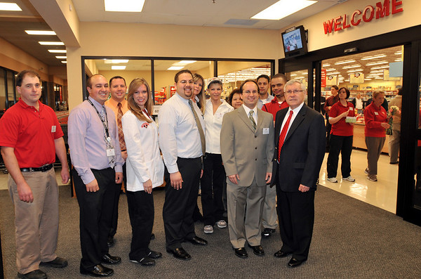 Peabody: Mayor Michael Bonfanti, right, stands with the Hannafords' store managagement at the grand re-opening.   photo by Mark Teiwes / Salem News