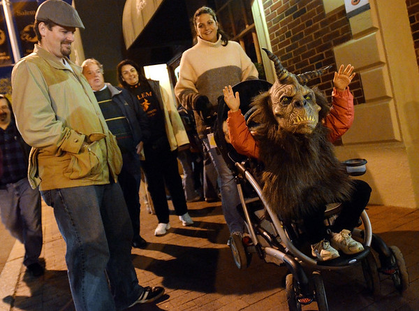 Salem: 5-year-old Norah Chapa of Metamora, MI, right, rolled around in a stroller ready to scare everyone passing by.  photo by Mark Teiwes / Salem News
