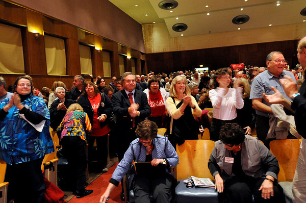 Beverly:  A lively capacity crowd claps at the end the debate at the Memorial building in Beverly.  The responses of the candidates evoked instances of cheers and boos.  photo by Mark Teiwes / Salem News