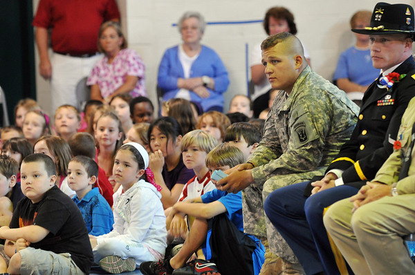 Danvers: Nathan Davis, left, visits Great Oak School where his fifth grade sister Rachel Davis attends. He is on a two week leave from serving in Afghanistan with the 101st Field Artillery. photo by Mark Teiwes / Salem News