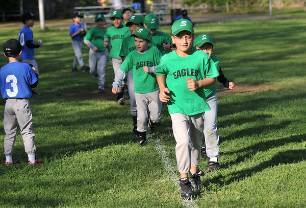 Salem: Jack Jermyn leads a warmup run before a game.  photo by Mark Teiwes / Salem News