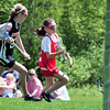 Boxford: U-13 girls Tribal Team player Charlotte Wallace of Boxford, right, carries the ball toward to goal past Ipswich defender Michaela Hedderman. photo by Mark Teiwes / Salem News