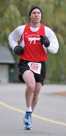 Salem:  John Ayers of Beverly won the 10th annual Witch City 5K road race with a time of 16 minutes 45 seconds.  photo by Mark Teiwes / Salem News