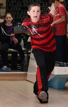 Peabody: Jake Marcinkowski winds up and takes aim down the alley.  photo by Mark Teiwes  / Salem News