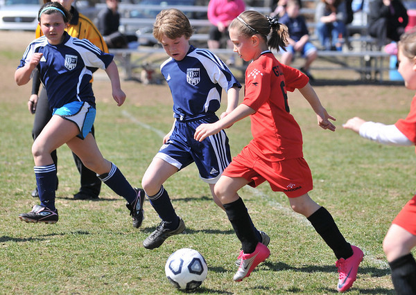 Middleton:  Middleton's Eliza Gildea carries the ball upfield followed by  Hamilton-Wenham's Hannah Moroney.  photo by Mark Teiwes / Salem News