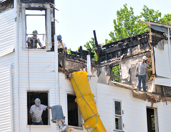 Salem: The first stage of rebuilding at 98 Washington Square East has started with a demolition crew from the Total Group company clearing away damaged material from last spring's fire.   photo by Mark Teiwes / Salem News
