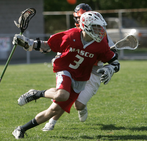 Beverly: Masco's Wes Shrewsbury sprints past a Beverly defender. photo by Mark Teiwes / Salem News