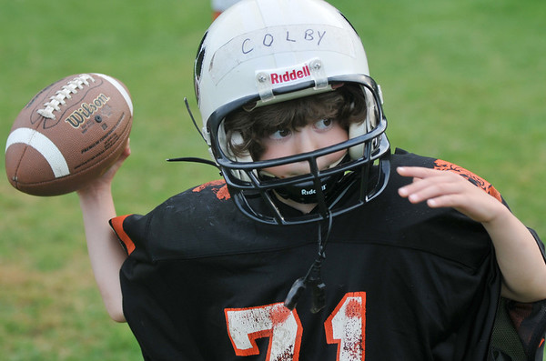 Beverly: Colby Mills, 6, practices as quarterback.  photo by Mark Teiwes /  Salem News
