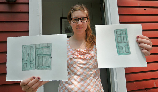 Peabody: Meghan Wicks, 21, holds pieces of art work in progress which she will later stitch together.  She is participating in an artist in residence program at Brooksby Farm.   photo by Mark Teiwes / Salem News