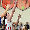 Boxford: Masconomet's Claudia Marsh puts up a shot past the Danvers defense.  photo by Mark Teiwes  / Salem News