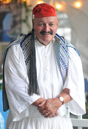 Ipswich: Bernie Kessel, of Peabody, came to the festival dressed in an authentic Greek costume completed with a fez hat.  photo by Mark Teiwes / Salem News