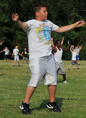 Salem: Francisco Mendoza, 12, of Peabody warms up at the start of the clinic.  photo by Mark Teiwes / Salem News