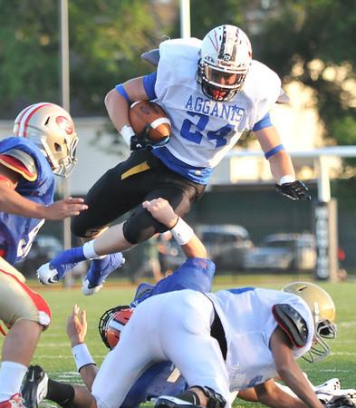 Lynn: Salem High School's Chris Bozarjian soars to gain yards at the  50th annual Agganis All-Star Football Classic .  photo by Mark Teiwes  / Salem News