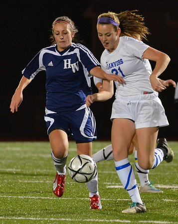 Lynn: Hamilton-Wenham's Caroline Savasta, left, and Danvers' Kristin Yost sprint shoulder-to-shoulder after the ball in division 2 north semifinals. photo by Mark Teiwes / Salem News