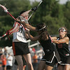 Ipswich: Ipswich captain Sarah Millard, left, releases a shot overhead to score on Marblehead.   photo by Mark Teiwes / Salem News