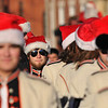 Beverly: Adam Contantine, senior percussion section leader, walks  with the Beverly High School marching band members all wearing Santa hats . photo by Mark Teiwes / Salem News