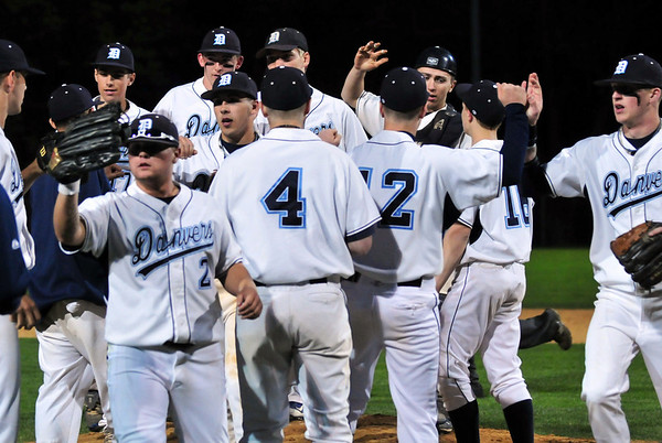 Danvers:  The Danvers High School baseball team celebrates their 2-0 win in a Northeastern Conference game against Peabody.  photo by Mark Teiwes / Salem News