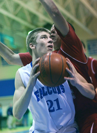 Danvers:  Danvers guard Nick Bates looks for a shot closely covered by Gloucester's Jordaon Shairs.  photo by Mark Teiwes / Salem News