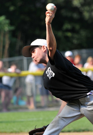 Beverly: Beverly West pitcher Cody Goodwin launches a pitch during the District 15 Little League championship game against Peabody West.  Mark Teiwes / Salem News
