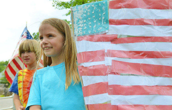 Wenham: William Eardley of Wenham, left, and his sister Sarah, both 7, wave homemade flags for Wenham's memorial day parade  photo by Mark Teiwes / Salem News