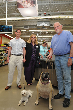 Beverly:  Jonathan Arst, left, Charlene St. Jean, and Henry Mcgowan came with dogs Shakti, left and Miltilda to Unleashed by PetCo. Photo by Mark Teiwes / Salem News