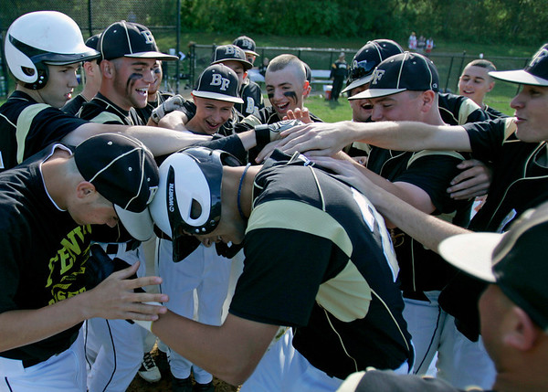 Peabody: The Bishop Fenwick High School baseball team celebrates a homerun by Gianni Esposito, center.  photo by Mark Teiwes / Salem News