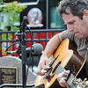 "Beverly: Tom ""Satch"" Kerans performs a song he wrote remembering 15 people who died in the July 4, 1984 fire.   photo by Mark Teiwes / Salem News"