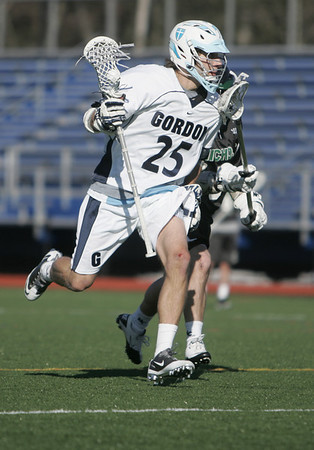 Wenham: Gordon College middie Dan Utz is on attack cruising around a Nichols player.  photo by Mark Teiwes / Salem News