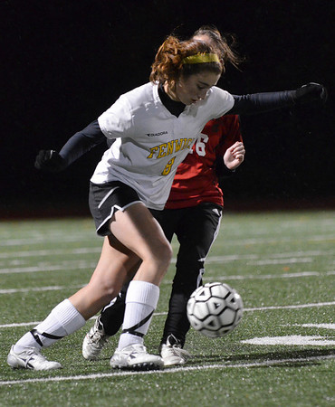 Peabody: Bishop Fenwick's Becky Mercuro dribbles the ball followed by a Salem defender.  She scored the games first goal. photo by Mark Teiwes / Salem News