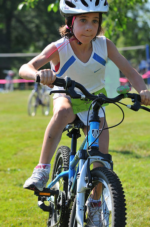 Hamilton: Lily Athanas of Manchester, 8, races in the TriROK Foundation's kids's triathlon at Patton Park.   photo by Mark Teiwes / Salem News