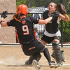 Beverly: At the Courtney Corning Memorial Softball Tournament Beverly's Kiki McKenna slides into home beating the throw with Bishop Fenwick catcher Amanda McInnis covering waiting for the ball. photo by Mark Teiwes / Salem News
