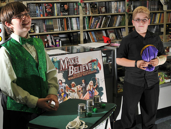 "Peabody:  Matthew Barr of Peabody, left and Derek DuBois of Everett, both 12-years-old are young magicians who, among other local appearances, appeared at a promotion for a film about teenage magicians, ""Make Believe.""   photo by Mark Teiwes / Salem News"