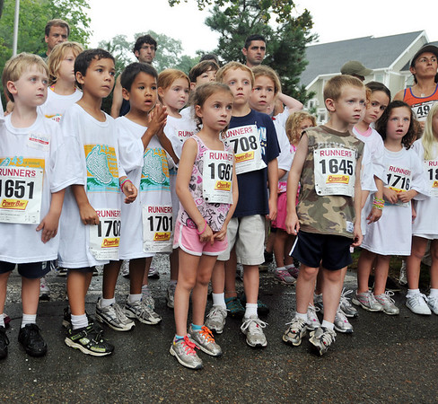 Beverly: 5, 6, and 7-year-olds line up ready for their race   photo by Mark Teiwes / Salem News