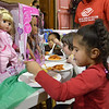 Salem: From right, Jayla Boyd, 6, Annie Welch, 5, and Amethyst Hines, 5, feast on pasta and cake after receiving presents during a Christmas party at Boys and Girls Club of Greater Salem. photo by Mark Teiwes  / Salem News