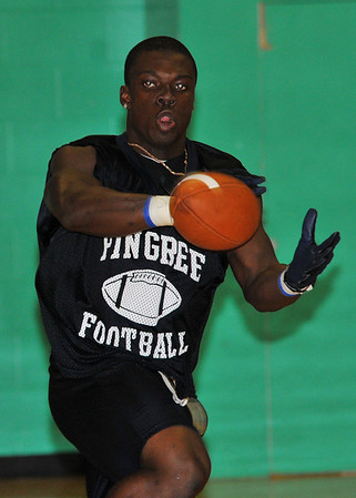 Hamilton: Running back and linebacker Kenny Adinkra reaches for the ball during a football practice at Pingree School.   Mark Teiwes / staff photo