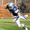 Hamilton: Hamilton-Wenham's quarterback Dylan Keith dives forward after being tripped up by a Lynnfield defender. photo by Mark Teiwes / Salem News